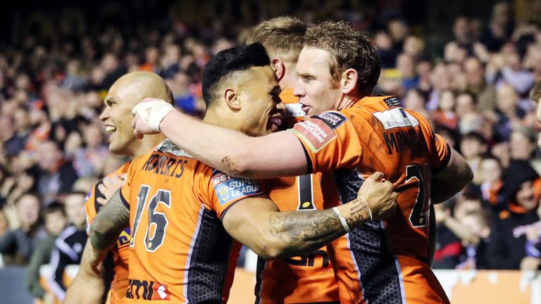 Castleford Tigers' Joel Monaghan (right) celebrates scoring a try with team-mates as the home side crushed Huddersfield 52-16