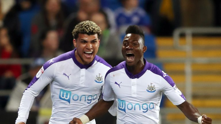 Christian Atsu (right) celebrates scoring Newcastle's first goal at Cardiff
