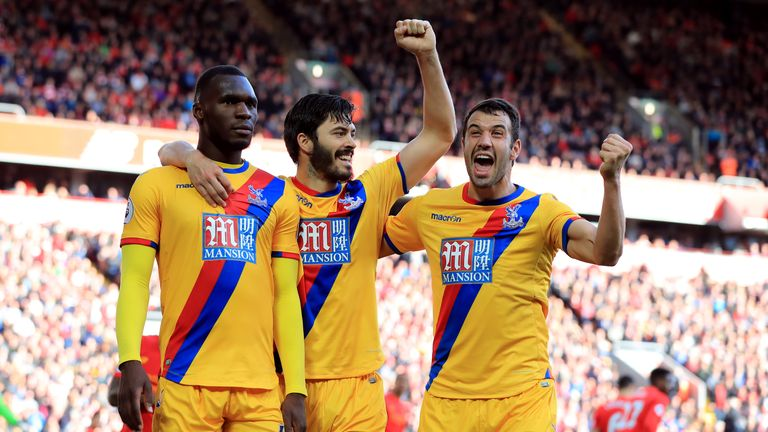 Crystal Palace's Christian Benteke celebrates scoring his side's second goal of the game with his team-mates during the Premier League match at Anfield, Li