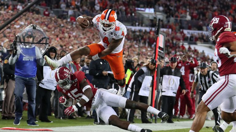 TAMPA, FL - JANUARY 09:  Quarterback Deshaun Watson #4 of the Clemson Tigers is stopped short of the goal line by defensive back Ronnie Harrison #15 of the