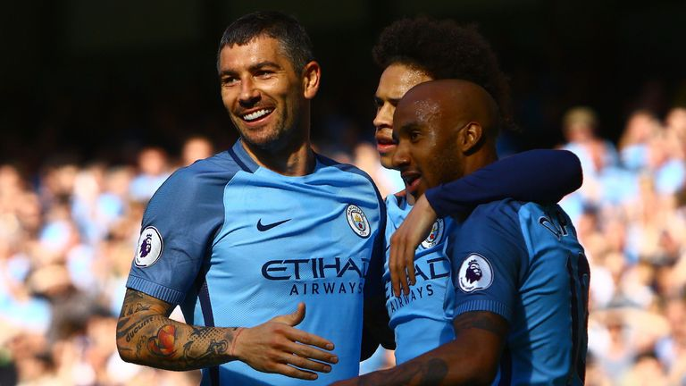 Manchester City's English midfielder Fabian Delph (R) celebrates scoring his team's third goal during the English Premier League football match between Man