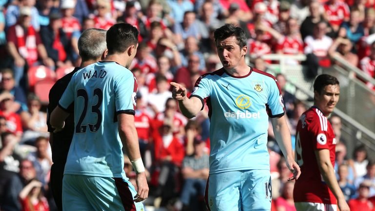 MIDDLESBROUGH, ENGLAND - APRIL 08: Joey Barton of Burnley (R) argues with referee Martin Atkinson during the Premier League match between Middlesbrough and