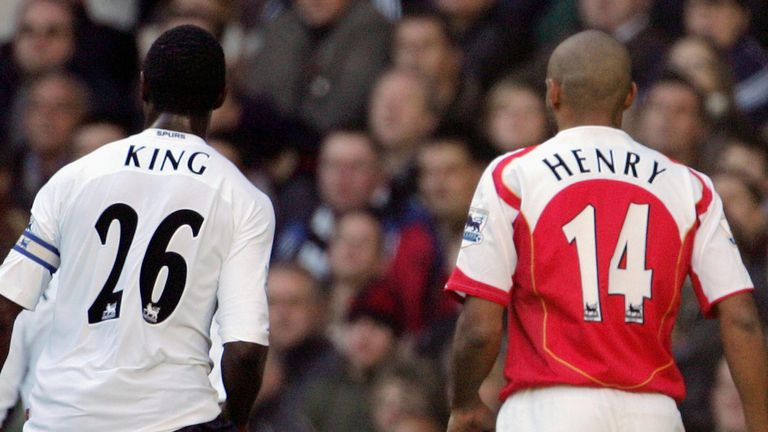 LONDON, UNITED KINGDOM:  Ledley King (L) of Tottenham follows Arsenal's Thierry Henry (R) across the field during their Premiership match at White Hart Lan