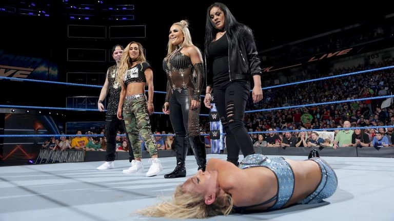 Carmella, Natalya and Tamina stand tall after their attack on Charlotte Flair and Naomi.