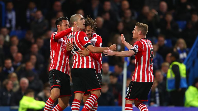 Oriol Romeu of Southampton (14) celebrates as he scores their first goal with team mates during the Premier League match between Chelsea and Southampton