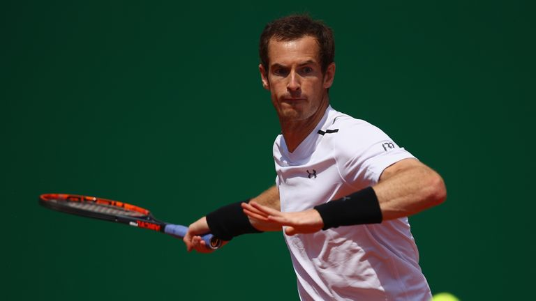 Andy Murray of Great Britain plays a forehand against Gilles Muller of Luxembourg