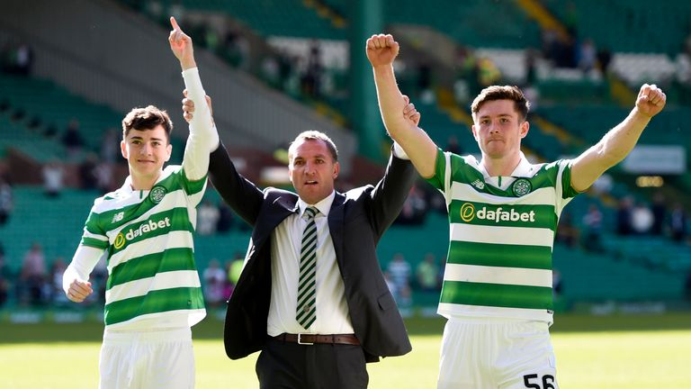 Brendan Rodgers celebrates with Michael Johnston and Anthony Ralston at full-time