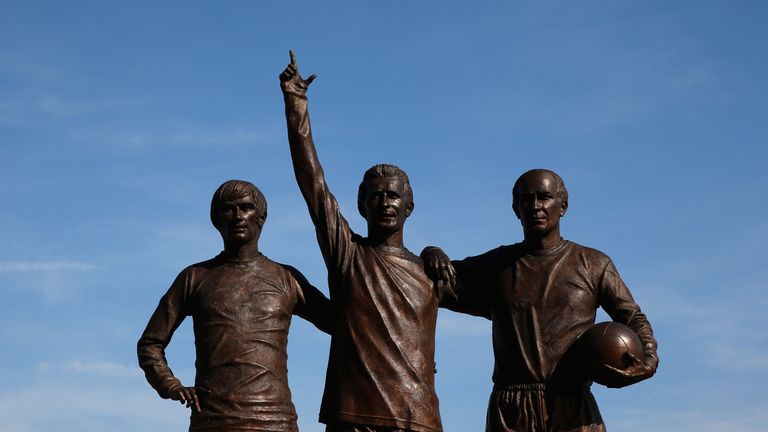 The statue of Law alongside George Best and Bobby Charlton outside Old Trafford
