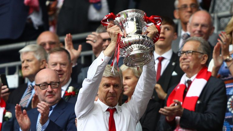 Wenger lifts the FA Cup after victory over Chelsea last season