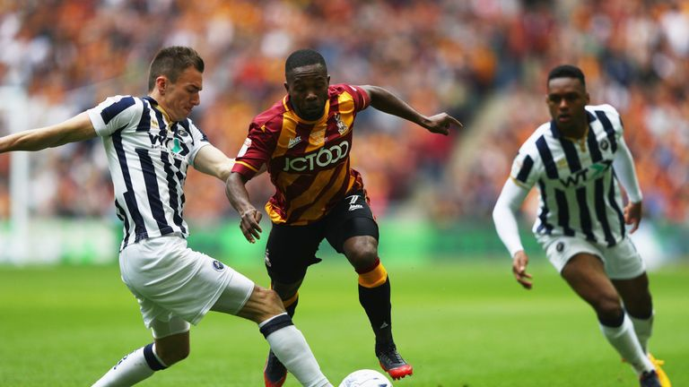 Bradford's Mark Marshall takes on Jed Wallace of Millwall