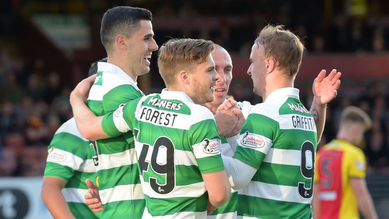 Celtic's Tom Rogic (left) celebrates with his team-mates after making it 2-0