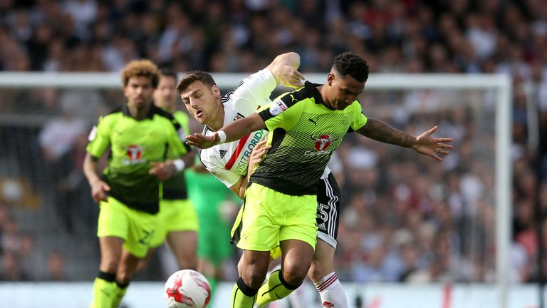 Fulham striker Chris Martin battles for the ball with Reading's Liam Moore