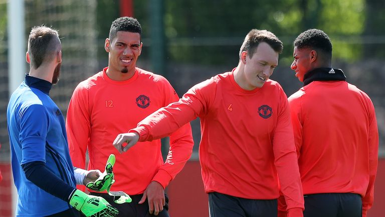 Chris Smalling (left) has recently changed agents ahead of the summer