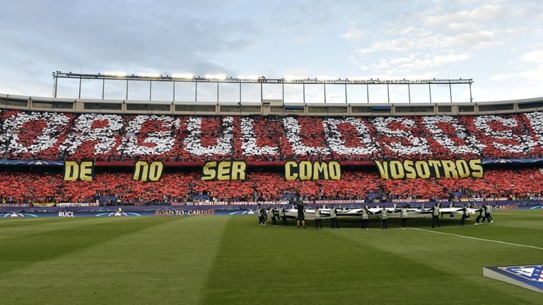 "Atletico fans created a mosaic to take aim at their city rivals, which read ""Proud to not be like you"""