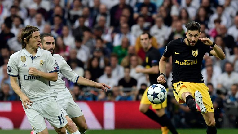 Yannick Ferreira Carrasco vies with Luka Modric and Dani Carvajal during the match