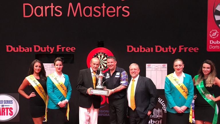 Gary Anderson retained his Dubai Duty Free Masters title with a superb victory over Michael van Gerwen