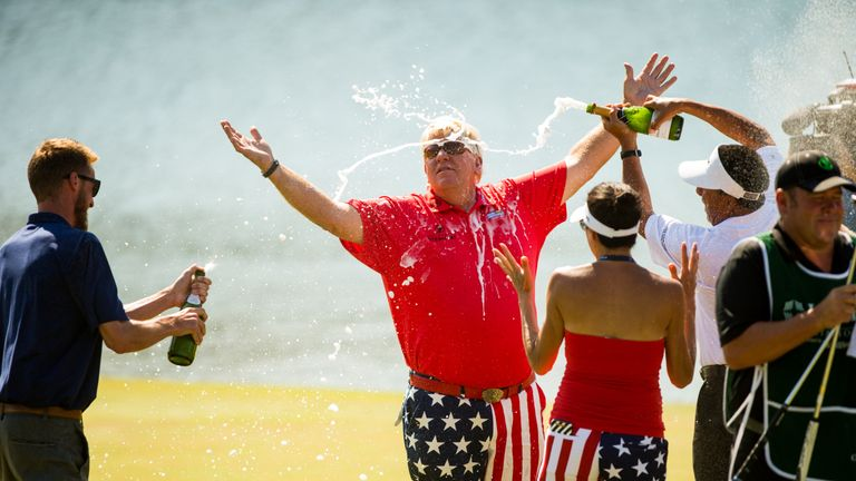 John Daly enjoys a champagne shower after winning the Insperity Invitational