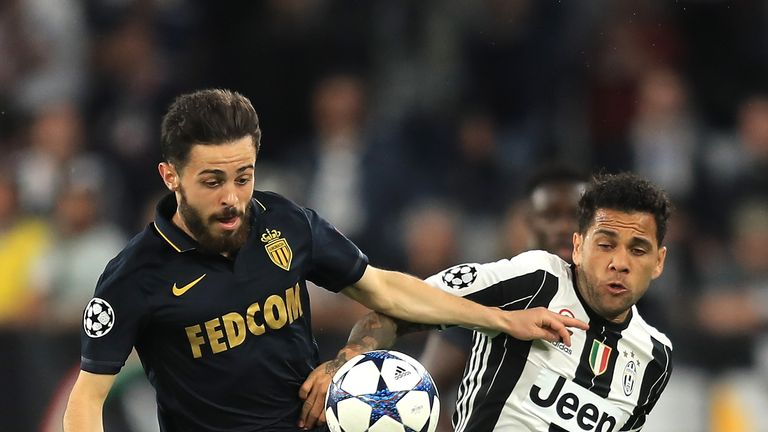 Bernardo Silva holds off Dani Alves in Turin