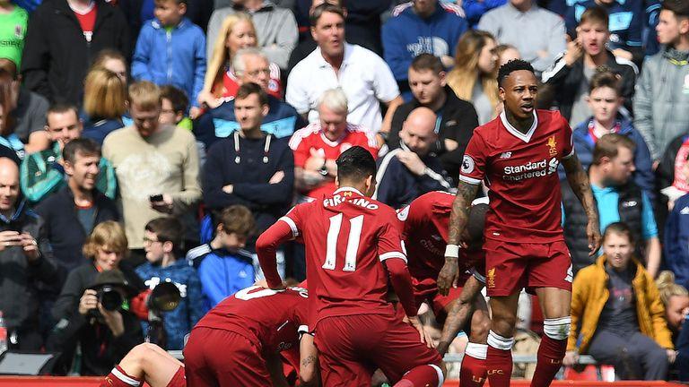 Liverpool players celebrate Adam Lallana's goal