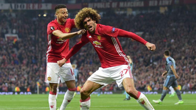 Marouane Fellaini celebrates putting Man Utd 2-0 ahead on aggregate