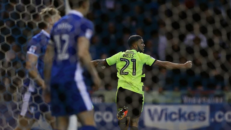 Nahki Wells of Huddersfield Town celebrates his equaliser at Hillsborough