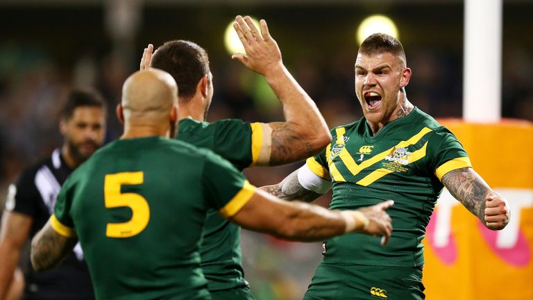 Josh Dugan (right) scored Australia's first try but was forced off with a suspected fractured cheekbone