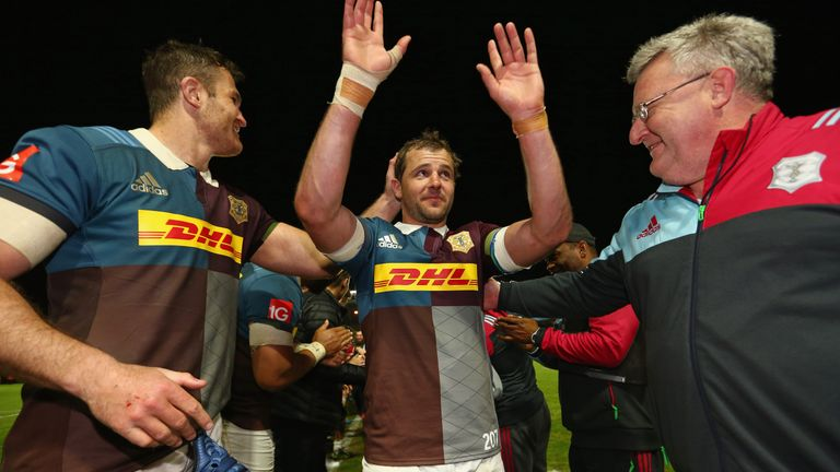 Nick Evans is clapped from the field by his team-mates and the coaching staff after his final match at the Stoop