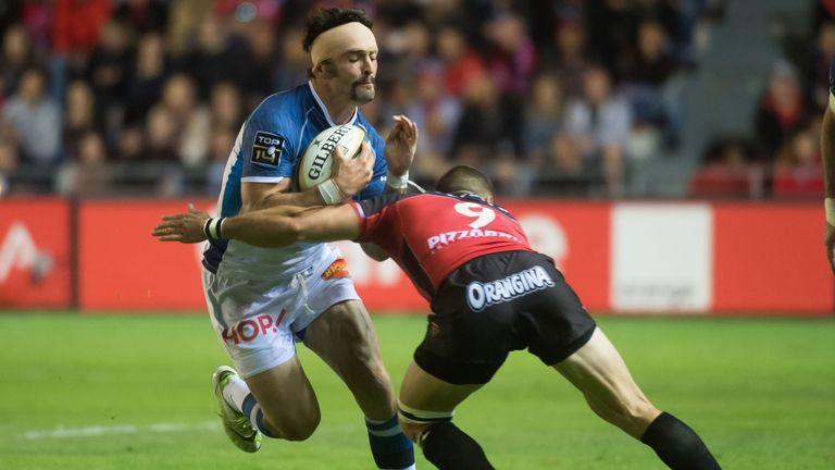 Thomas Combezou (L) vies with Toulon's scrum-half Sebastien Tillous-Borde