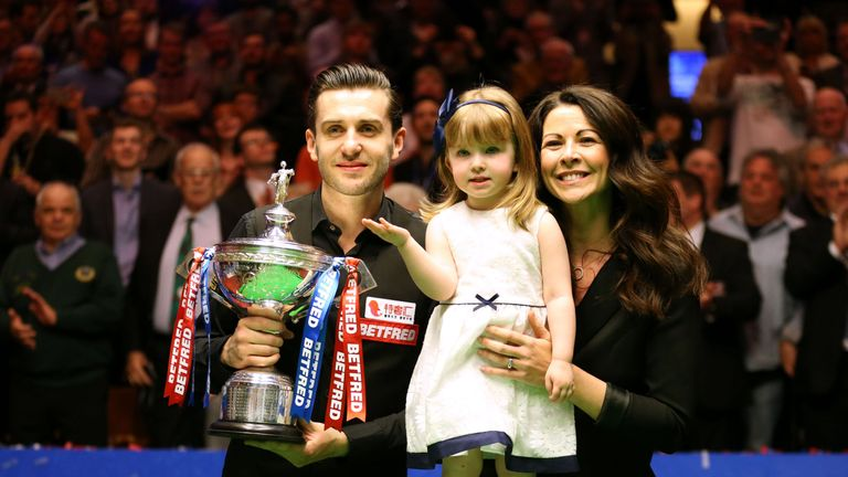 Selby celebrates with his daughter and wife