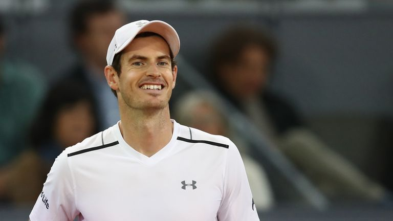 Andy Murray smiles towards his box during his surprise defeat to Borna Coric