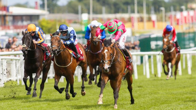 Visionary ridden by Jamie Spencer (right) wins the Shalaa Carnarvon Stakes