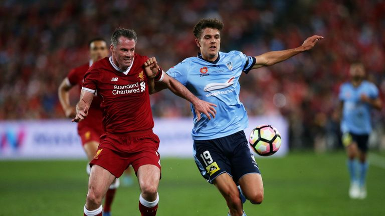SYDNEY, AUSTRALIA - MAY 24:  George Blackwood of Sydney FC is challenged by Jamie Carragher of Liverpool during the International Friendly match between Sy
