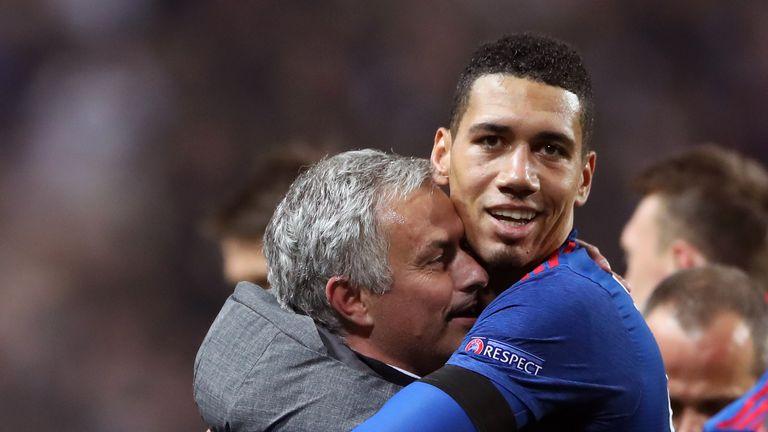 Chris Smalling and Jose Mourinho celebrate winning the Europa League