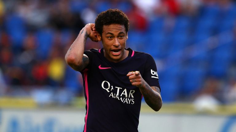 LAS PALMAS, SPAIN - MAY 14: Neymar of Barcelona celebrates by pointing to a tattoo on his arm after scoring his third goal and the teams fourth of the game
