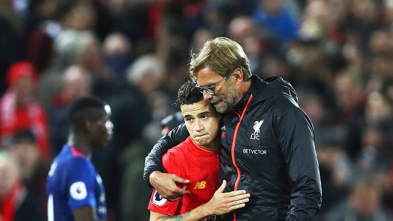 Jurgen Klopp talks with Philippe Coutinho after the match against Manchester United at Anfield