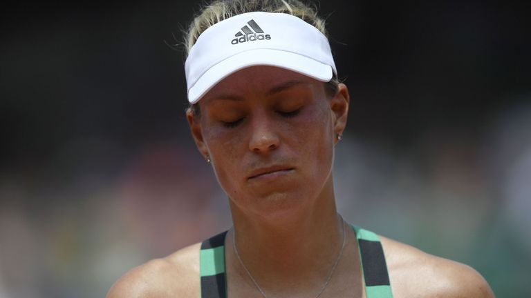 Germany's Angelique Kerber reacts during her qualification round match against Russia's Ekaterina Makarova at the Roland Garros 2017 French Tennis Open