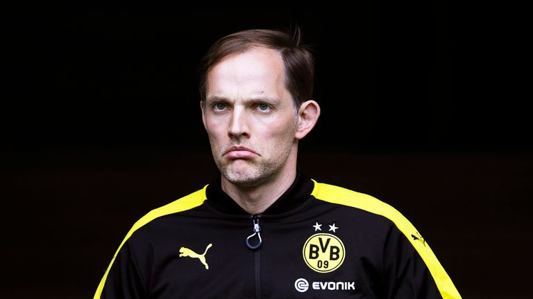 Thomas Tuchel walks out to the pitch before the Bundesliga match between FC Augsburg and Borussia Dortmund