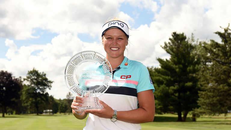 Brooke Henderson with the spoils of victory