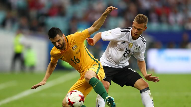 Australia's Aziz Behich and Joshua Kimmich of Germany battle for possession