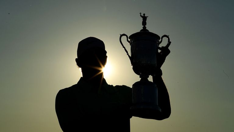 Brooks Koepka holds the US Open trophy