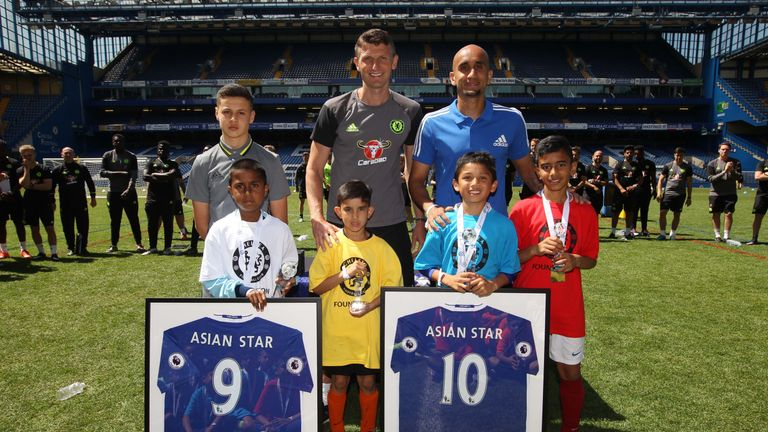 Rehman alongside Chelsea youth coach Tore Andre Flo at the Asian Star event