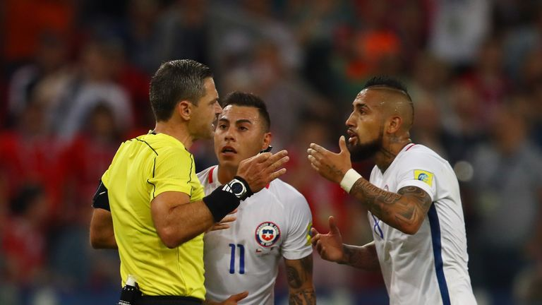 Arturo Vidal appeals to referee Damir Skomina after Chile's goal was disallowed