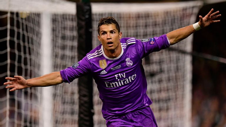 Cristiano Ronaldo celebrates his second goal as Real win Champions League