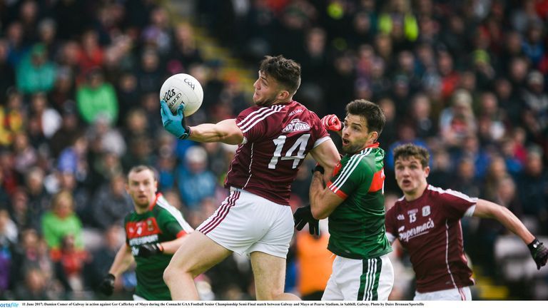 Damien Comer of Galway in action against Ger Cafferkey of Mayo