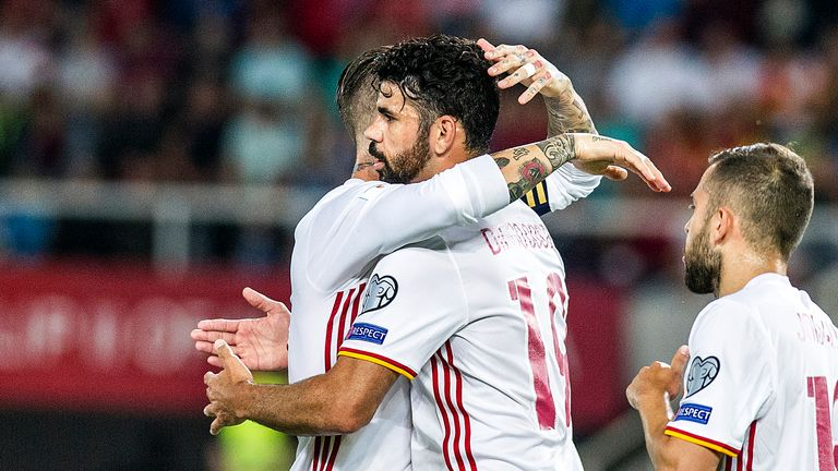 Costa is congratulated by Sergio Ramos after scoring in Spain's 2-1 win over Macedonia