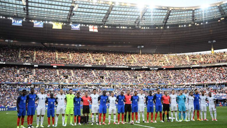 England and French players stand together ahead of the international friendly