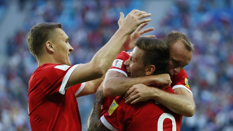Fedor Smolov celebrates scoring Russia's second goal.