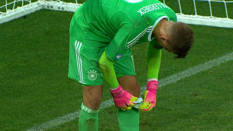 Germany 'keeper Julian Pollersbeck consults his notes during the penalty shootout with England in the U21 Euros semi-finals