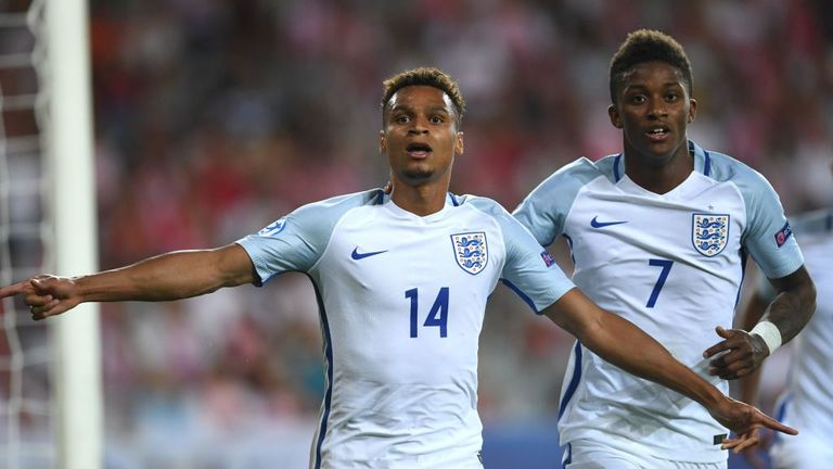 England's forward Jacob Murphy (L) celebrates scoring with his teammate midfielder Demarai Gray