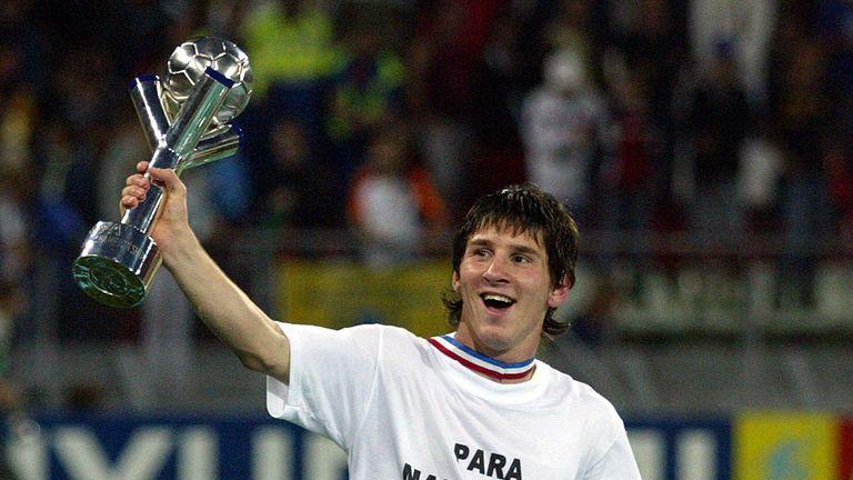 Argentina's Lionel Messi holds the 2005 Under-20 trophy aloft
